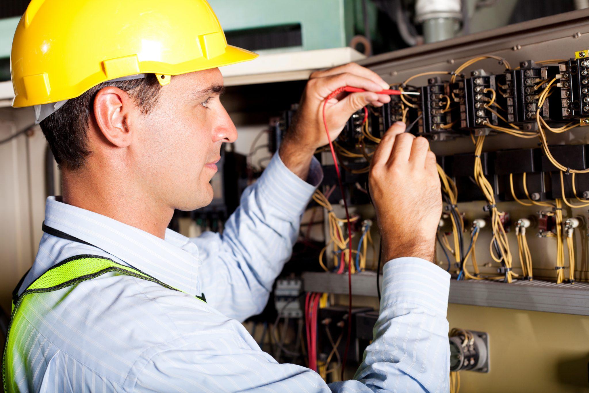 kelowna-electrician-epic-electric-electrician-working-on-circuit-board-1